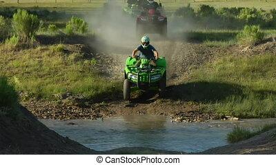 ATV riders cross stream