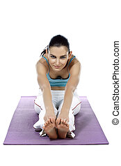 young lady doing sit and reach in yoga