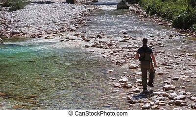 Fisherman - Photo of a Fisherman in the Soca river, Slovenia