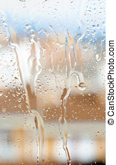 raindrops slide down the windowpane