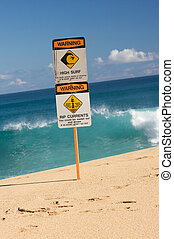 Surf and Currents Warning Sign on a beach in Hawaii