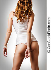 Perfect female body Woman wearing white cotton undershirt...