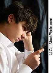 Sad Teenager - Sad and Sorrowful teenager with Mobile Phone