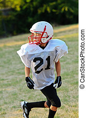 Young Football Player - Young football player going out for...