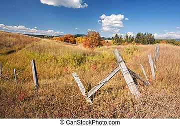 Beautiful Fall Landscape with Rustic Fence and Clouds