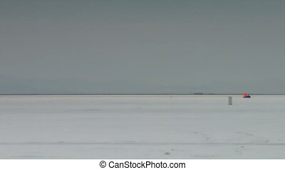 dragster passes camera at high speed on Bonneville salt...