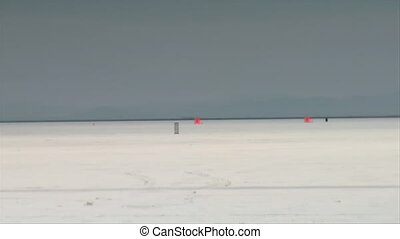 motorcycle passes camera at high speed on Bonneville salt...