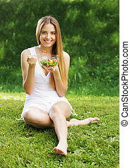 Healthy woman eating salad - Portrait of happy beautiful...