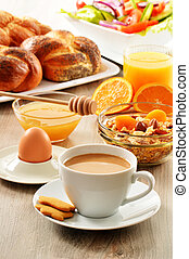Breakfast including coffee, bread, honey, orange juice,...