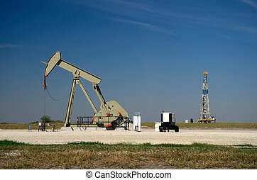 Derrick and Jack - Pump jack with a derrick drilling a new...