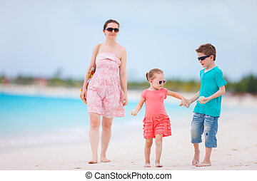 Family on tropical beach vacation