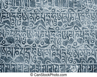Buddhist mantra carved in stone