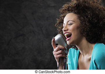 Female singer - Young female singer with brown curly hair...