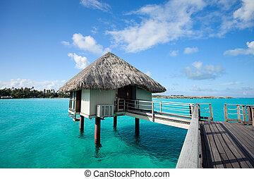 Overwater bungalow - Resort bungalow over tropical water in...