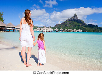 Family on Bora Bora vacation - Mother and daughter at...