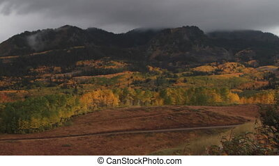 panning shot across mountains and fall colors