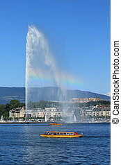 "Water fountain with rainbow and famous yellow ""mouette"" boat..."
