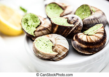 Escargots with garlic butter and lemon