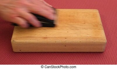 finish sanding - hand finishing of a small butcher block...
