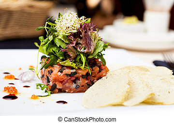 Salmon tartar with red caviar and ginger croutons