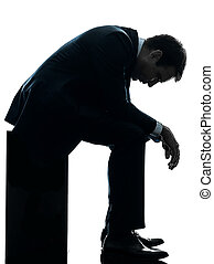 sad business man sitting pensive silhouette - one caucasian...