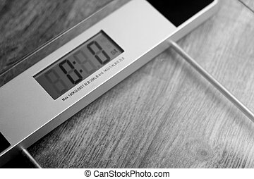 Digital Weighing Scales - A black and white close up of...