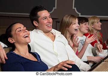 Laughing audience at the movies - Laughing people in a...