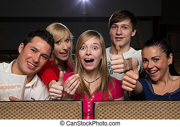 Happy people in movie theatre - Group of happy people having...