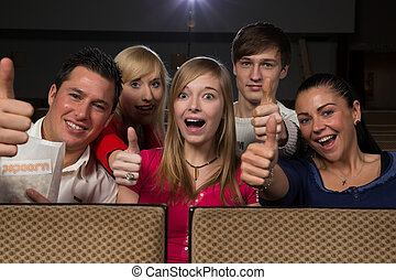 Happy people in movie theatre