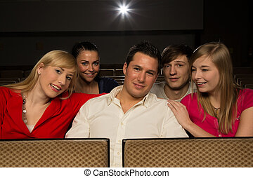 Man with friends in a cinema