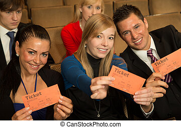 Audience members presenting tickets - Group of audience...