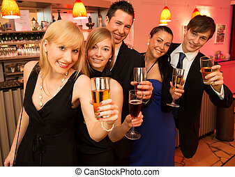 Group of five people standing in line celebrating - Group of...