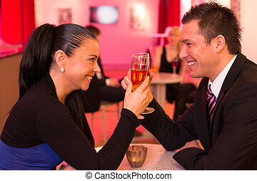 Couple in love enjoying drinks - Couple in a bar enjoying...