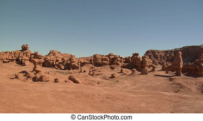panning across boulders in goblin Valley Utah