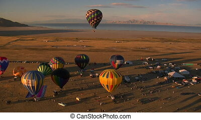 hot air balloon Festival shot from the air with Lake in...