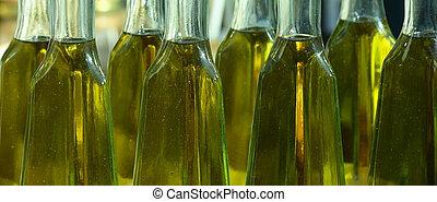 Olive oil in bottles - Home-made olive oil in bottles on a...