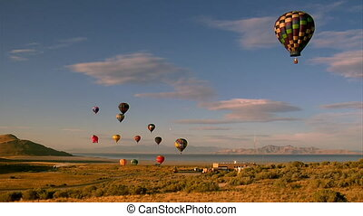 hot air balloons lifting into the sky shot from basket