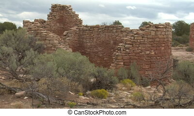 panning shot revealing ruins at at Hovenweep national...
