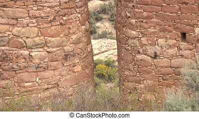 tilt up shot revealing ruins at Hovenweep national Monument