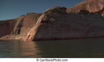 ski boat makes turn in Lake Powell canyons Utah