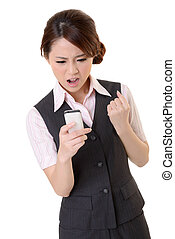 Angry business woman looking message on mobile phone,...