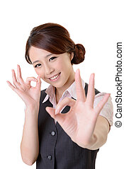ok - Asian business woman give you OK gesture, close up...
