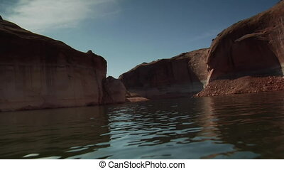 slow-motion POV of red canyons like how Utah
