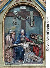 13th Stations of the Cross, Jesus body is removed from the...