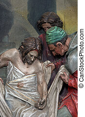 14th Stations of the Cross, Jesus is laid in the tomb and...