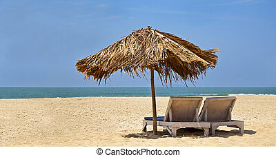 Loungers desserted beach blue sky - Panorama of a generic...