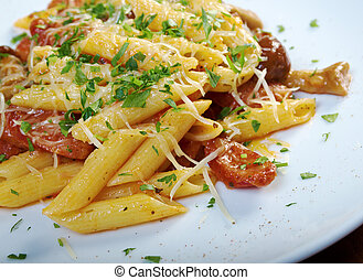 Italian Penne rigate pasta with sausage,perish