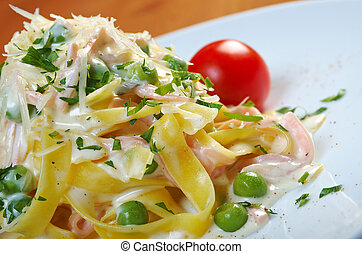 pasta Fettuccine Alfredo with cherry tomato, ham close-up