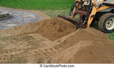 Front End Loader Moves Dirt Pile - A front end loader moves...