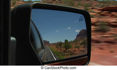 Monument Valley Highway in rearview mirror
